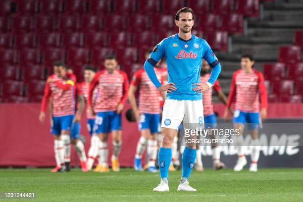Napoli's Spanish midfielder Fabian Ruiz reacts to Granada's second goal during the UEFA Europa League round of 32 first leg football match between...