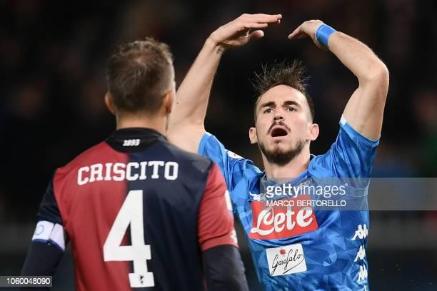 Napoli's Spanish midfielder Fabian Ruiz runs past Genoa's Italian defender Domenico Criscito as he celebrates after scoring during the Italian Serie...