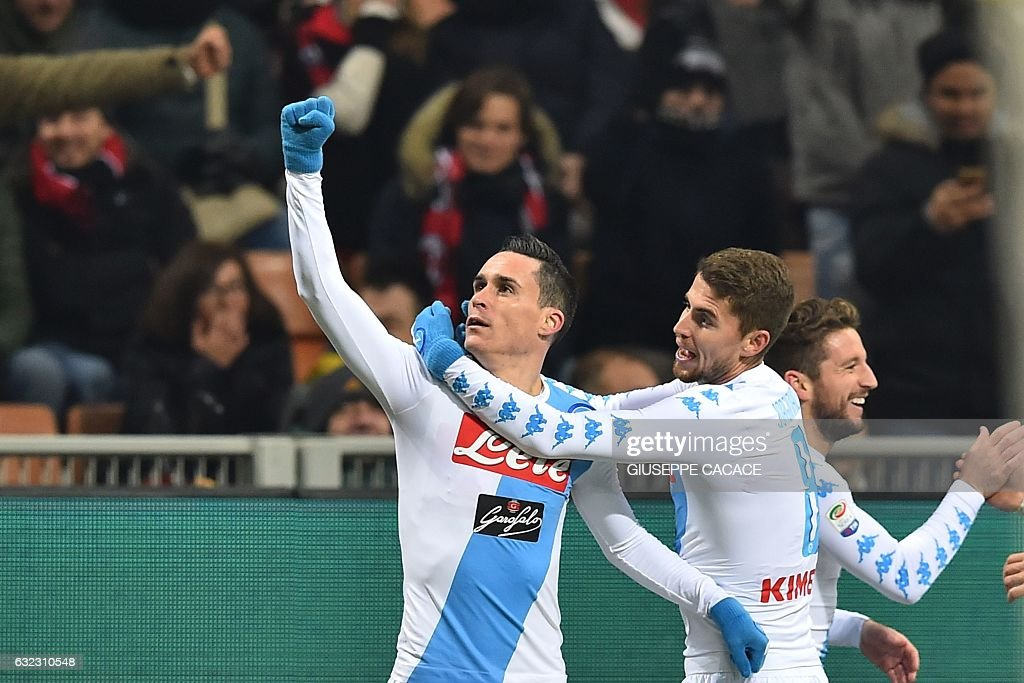 Napoli's Spanish midfielder Jose Maria Callejon (L) celebrates with teammates after scoring a goal during the Italian Serie A football match between AC Milan and Napoli at the San Siro Stadium in Milan on January 21, 2017. / AFP / GIUSEPPE