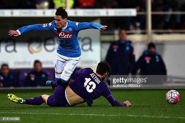 Napoli's Spanish midfielder Jose Maria Callejon vies for the ball with Fiorentina's Italian defender Davide Astori during the Italian Serie A...