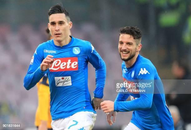 Napoli's Spanish striker Jose Maria Callejon celebrates after scoring with teammate Napoli's Belgian striker Dries Mertens during the Italian Serie A...
