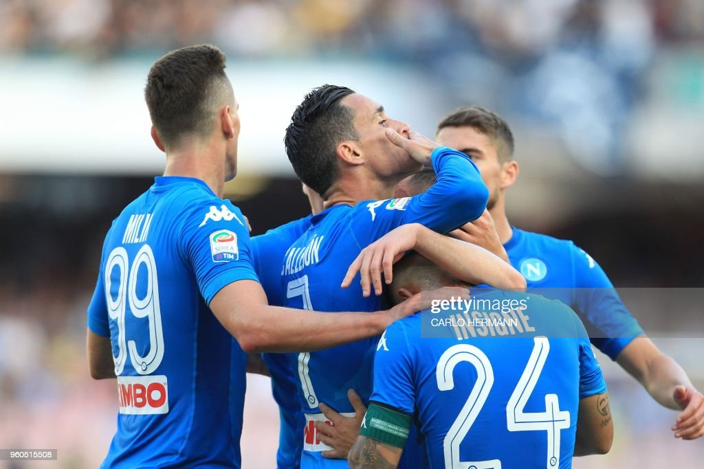 Napoli's Spanish striker Jose Maria Callejon (C) celebrates with teammates after scoring during the Italian Serie A football match SSC Napoli vs FC Crotone on May 20, 2018 at the San Paolo Stadium.