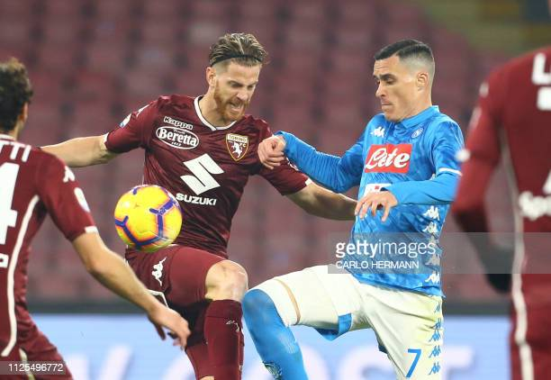 Napoli's Spanish striker Jose Maria Callejon fights for the ball with Torino's defender from Argentina Cristian Ansaldi during the Italian Serie A...