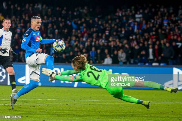 Napoli's Spanish striker Jose Maria Callejon fights for the ball with Genk's Belgian goalkeeper Maarten Vandervoort during the UEFA Champions League...