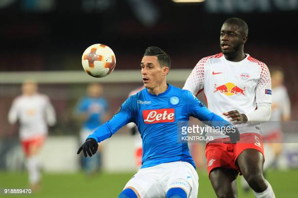 STADIUM NAPLES CAMPANIA ITALY Napoli's Spanish striker Jose Maria Callejon fights for the ball with Leipzig's French defender Dayot Upamecano during...