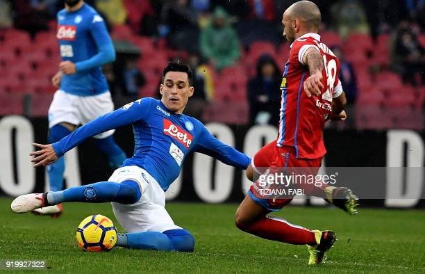 Napoli's Spanish striker Jose Maria Callejon fights for the ball with Spal's Italian midfielder Pasquale Schiattarella during the Serie A football...