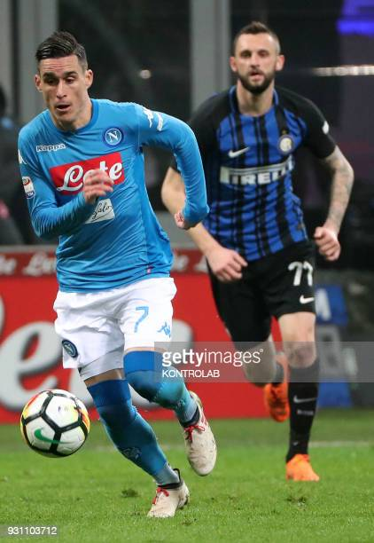 STADIUM MILAN LOMBARDIA ITALY Napoli's Spanish striker Jose Maria Callejon runs for the ball followed by Inter Milan's Croatian midfielder Marcelo...