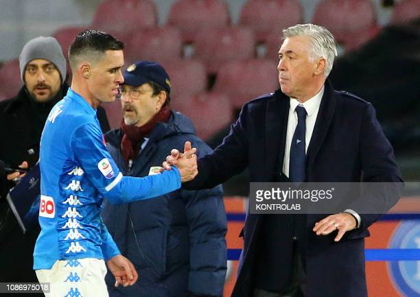 Napoli's Spanish striker Jose Maria Callejon shake hands with Napoli's Italian coach Carlo Ancelotti during the Italian Serie A football match SSC...