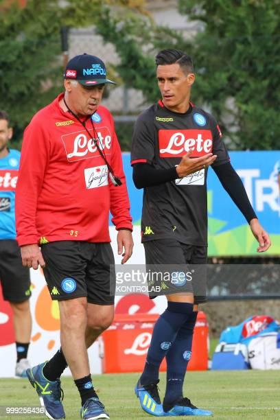 Napoli's Spanish striker Jose Maria Callejon talks with Napoli's Italian coach Carlo Ancelotti during the preseason praparation on July 13 2018 at...