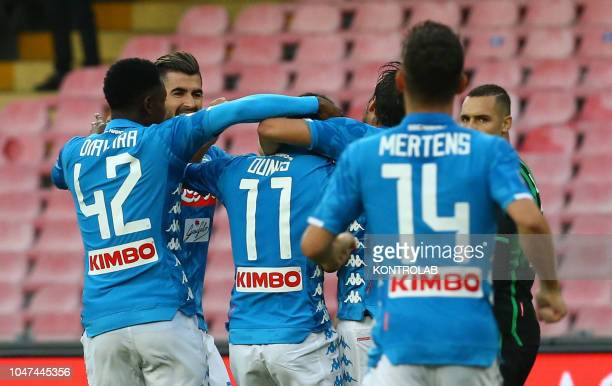 STADIUM NAPLES CAMPANIA ITALY Napoli's striker from France Adam Ounas celebrates with teammates after scoring a goal during the Italian Serie A...
