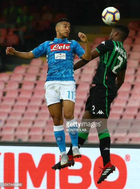 STADIUM NAPLES CAMPANIA ITALY Napoli's striker from France Adam Ounas heads the ball as fighting with Sassuolo's Brazilian defender Marlon during the...