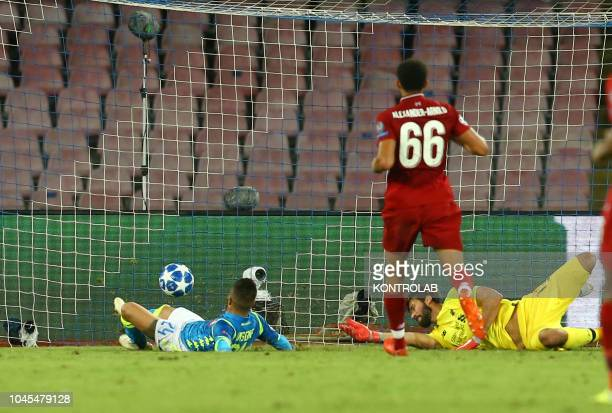 STADIUM NAPLES CAMPANIA ITALY Napoli's striker from Italy Lorenzo Insigne scores against Liverpool's Brazilian goalkeeper Allison Becker during the...