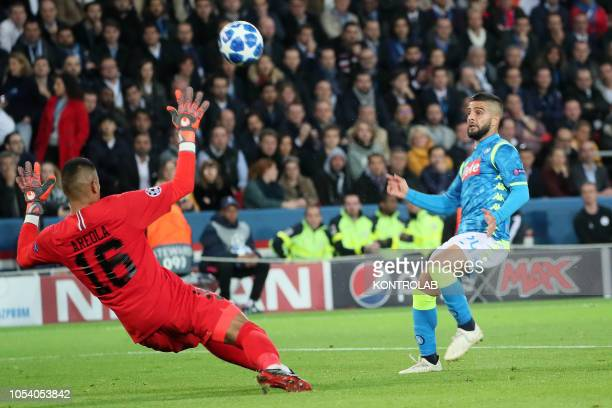 Napoli's striker from Italy Lorenzo Insigne scores against Paris Saint Germain's French goalkeeper Alphonse Areola during the UEFA Champions League...