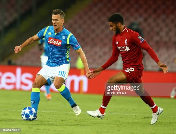 STADIUM NAPLES CAMPANIA ITALY Napoli's striker from Poland Arkadiusz Milik fights for the ball with Liverpool's English defender Nathaniel Clyne...