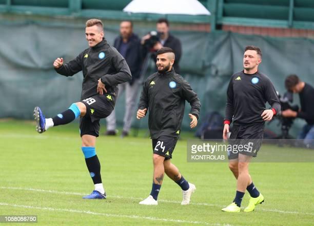 Napoli's striker from Poland Arkadiusz Milik Napoli's striker from Italy Lorenzo Insigne and Napoli's defender from Portugal Mario Rui take part to a...