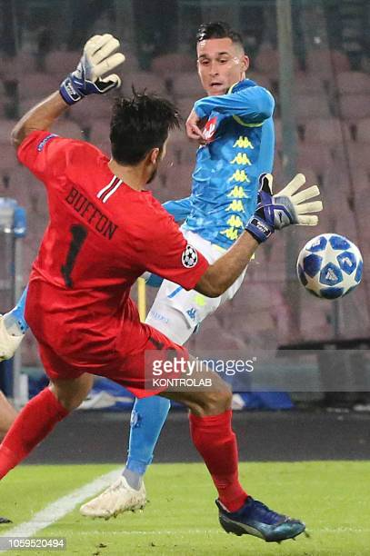 Napoli's striker from Spain Jose Maria Callejon kicks the ball against Paris Saint Germain's Italian goalkeeper Gianluigi Buffon during the UEFA...