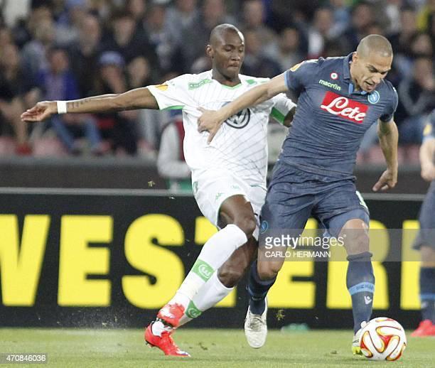 Napoli's Swiss midfielder Gokhan Inler fights for the ball with Wolfsburg's Brazilian defender Brazil Naldo during the UEFA Europa League quarter...