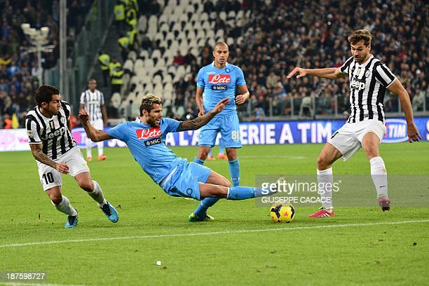 Napoli's Swiss midfielder Valon Behrami vies with Juventus' Spanish foward Fernando Torres Llorente during the Italian Serie A match between Juventus...