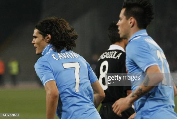 Napoli's Uruguayan forward Edinson Cavani and Marek Hamsik celebrate after scoring during the return football match of the semi finals of the Cup of...