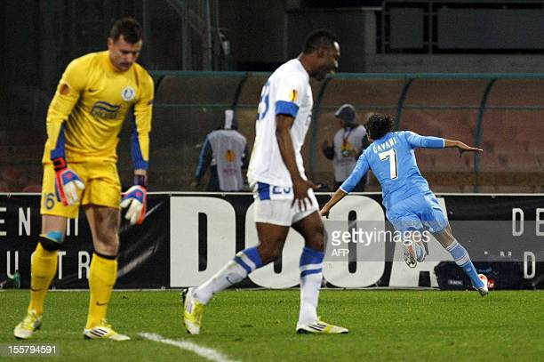 Napoli's Uruguayan forward Edinson Cavani celebrates after scoring a goal despite Dnipro's goalkeeper Czech Lan Lastuvka and Dnipro's Nigerian...
