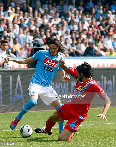 Napoli's Uruguayan forward Edinson Cavani fights for the ball with Nicolas Spolli, Argentinian defender of Catania, during the Italian Serie A...