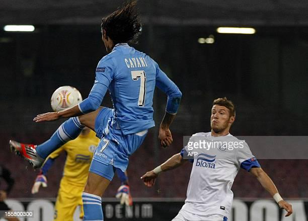 Napoli's Uruguayan forward Edinson Cavani fights for the ball with Ukrainian Dnipro's captain Ruslan Rotan during an UEFA Europa league Group F...