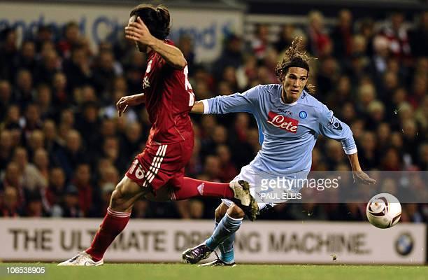Napoli's Uruguayan forward Edinson Cavani is challenged by Liverpool's Greek defender Sotirios Kyrgiakos during their UEFA Europa League football...