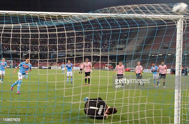 Napoli's Uruguayan forward Edinson Cavani scores a penalty during an Italian Serie A football match between SSC Napoli and USC Palermo in San Paolo...