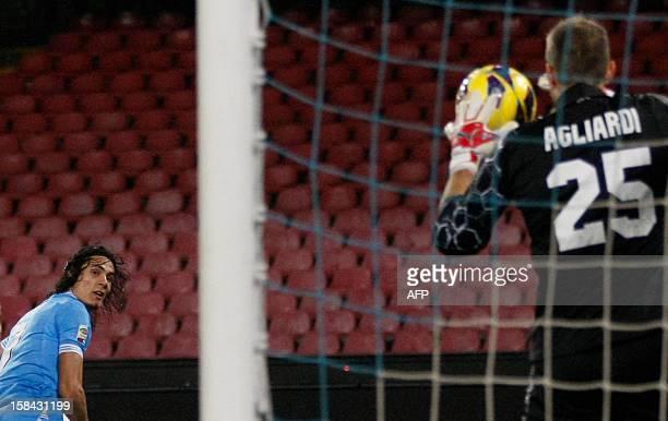 Napoli's Uruguayan forward Edinson Cavani watches as Bologna's goalkeeper Italian Federico Agliardi catches the ball during the Serie A football...