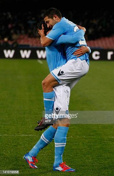 Napoli's Uruguayan forward Walter Gargano celebrates with teammate Uruguayan edinson Cavani during the Italian serie A football match between SSC...