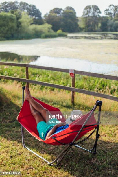 napping by the river - england stock pictures, royalty-free photos & images