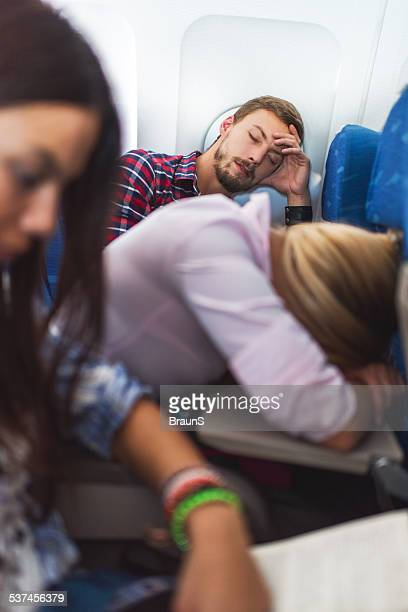 Napping in airplane.