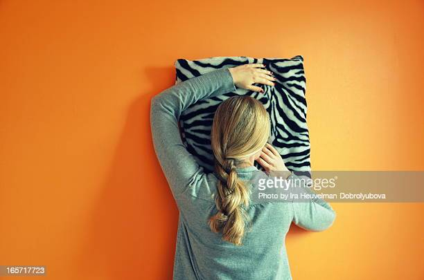 Napping on the orange wall
