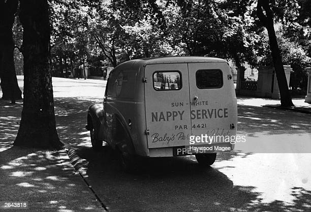 A nappy laundry service van parked in Kensington Palace Gardens Original Publication Picture Post 6006 What's In the Bag pub 1952