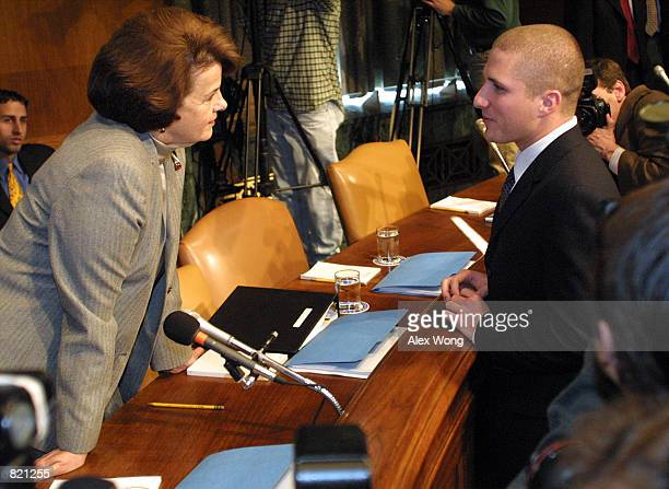 Napster founder Shawn Fanning right speaks with Sen Dianne Feinstein prior to a hearing on online entertainment April 3 2001 before the Senate...