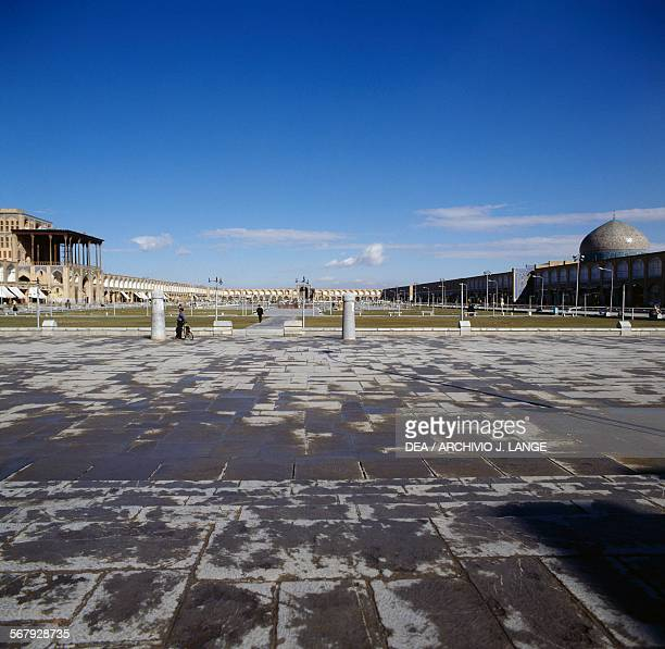 Naqsh-e Jahan square or Imam square , with Ali Qapu palace on the left and the dome of the Sheikh Lotfollah mosque on the right, Isfahan , Iran.