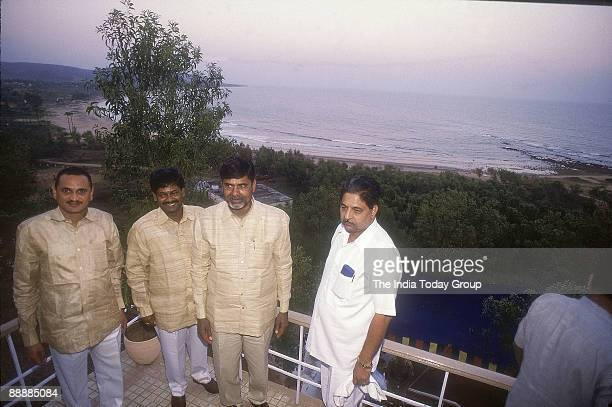 Nara Chandrababu Naidu Chief Minister of Andhra Pradesh withr Party Leaders standing in a hotel near Sea
