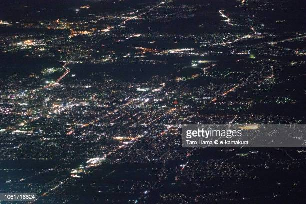 Nara city in Nara prefecture in Japan night time aerial view from airplane