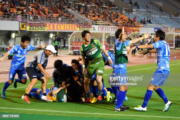 Nara Club players celebrate their victory through the penalty shootout after the 98th Emperor's Cup second round match between Nagoya Grampus and...