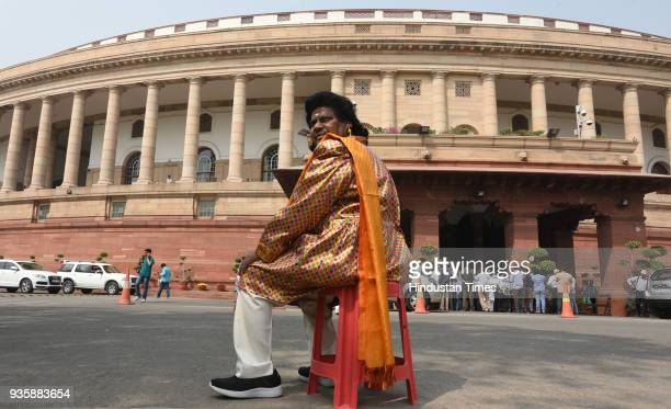 Naramalli Siva Prasad dressed as a Raja Harish Chandra protests demanding special status for the state of Andhra Pradesh during the Budget Session of...