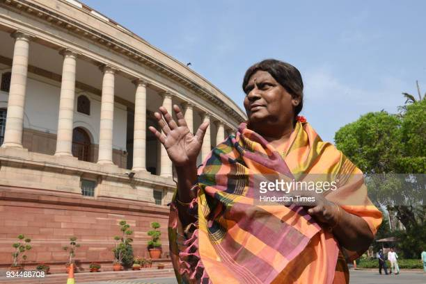 Naramalli Sivaprasad wears sari during a protest demanding a special status for the state of Andhra Pradesh at the Budget Session of Parliament on...