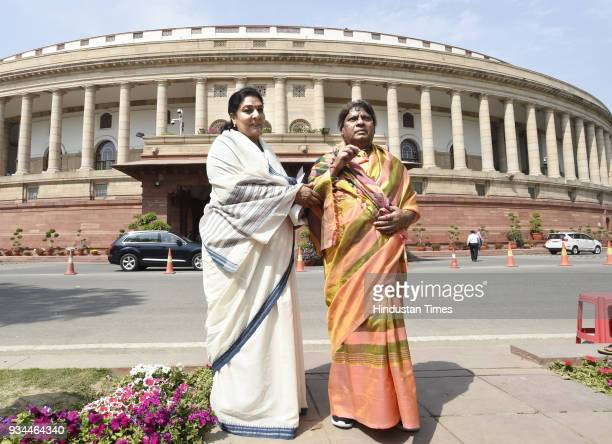 Naramalli Sivaprasad wears Sari with Congress leader Renuka Choudhary in protest demanding a special status for the state of Andhra Pradesh during...