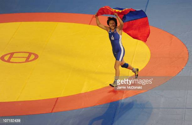 Naranch Gelegjamts of Mongolia wins Gold during the Women's Freestyle 72kg Gold Medal event at Huagong Gymnasium during day fourteen of the 16th...