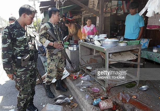 Thai soldiers inspect a food stall damage cause from an exploded bomb by Islamic rebels in Narathiwat province 25 April 2007 More than 2100 people...