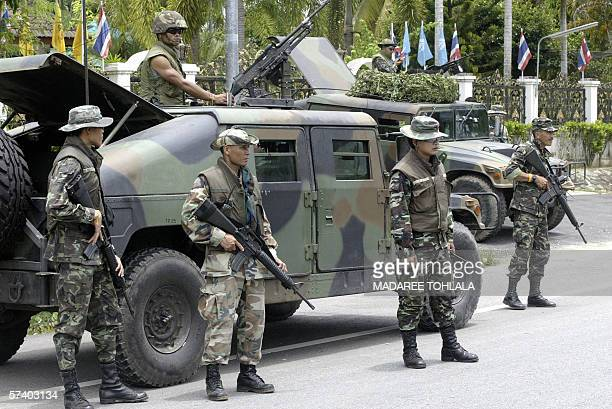Thai soldiers stationed in the vicinity of a polling station during the byelections vote in Thailand's troubled southern Narathiwat province 23 April...