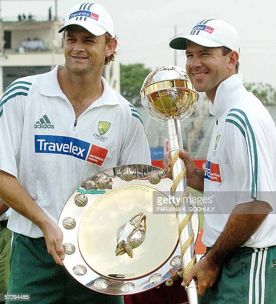 Australian cricket captain Ricky Ponting and wicketkeeper Adam Gillchrist hold the LG International Cricket Council ranking trophies for the best...