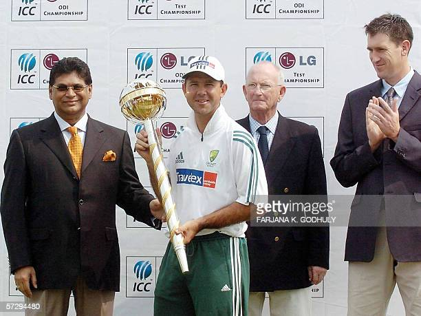 Australian cricket team captain Ricky Ponting holds the LG International Cricket Council ranking trophy for the best test team of the year as...