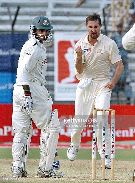 Australian cricketer Jason Gillespie celebrates the dismissal of Bangladeshi batsman Javed Omar during the third day of the first Test match between...