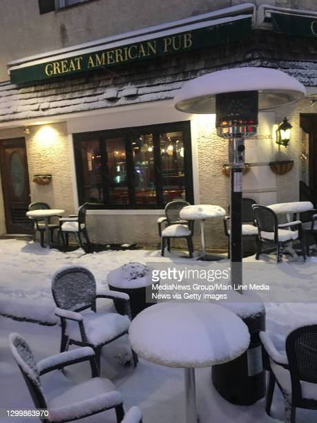 Narberth, PA. Feb. 1 :Snow covered tables at the Great American Pub in Narberth as a winter storm dumped up to six inches of snow on the Main Line.