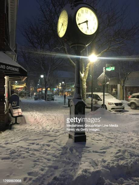 The town clock in Narberth is a lonely place on a snowy Monday evening.